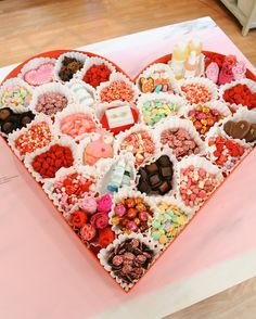 For a one-of-a-kind Valentine's Day gift, fill an oversize heart box with small gifts handpicked for your one-and-only.