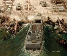 ModelCrafters was commissioned to build a commemorative WWII D-Day diorama of Omaha Beach, Normandy, France. | by modelcrafters@yahoo.com