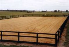 Large rectangular outdoor riding arena. I want something like this but with white vinyl fencing :)