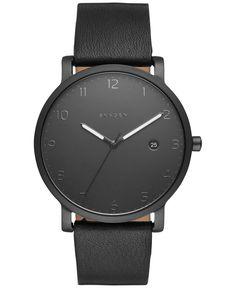 Dramatic lines meet dark tones in this exceptional Hagen watch designed by Skagen. | Black leather strap | Round black stainless steel case, 40mm | Black dial with numerals, three hands, date window