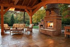 Wood and stone backyard covered patio and fireplace reminds me of Texas hill country type living. Outdoor Areas, Outdoor Rooms, Outdoor Living, Indoor Outdoor, Outdoor Decor, Outdoor Kitchens, Outdoor Patios, Backyard Covered Patios, Backyard Patio