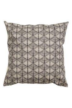 Housse de coussin à motif: Housse de coussin en toile de coton avec motif imprimé devant. Dos uni. Fermeture à glissière dissimulée.