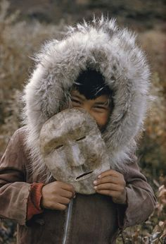 A Nunamiut Boy and Mask, Alaska, c. 1958 - Photo by Thomas J. Abercrombie