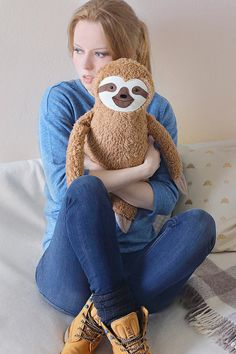 This cute sloth stuffed animal is made of soft wool felt (face) and cotton plush.  The mouth is hand-embroidered. It is softly stuffed with