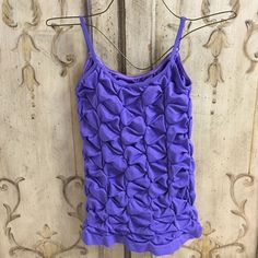 Tank Top NWOT. Beautiful purple color seamless tank. Has adjustable straps. Size M but runs small. Tighter fit. Connection 18 Tops Tank Tops