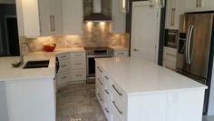White cabinets marble floors, marble backsplash