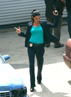 Angie Harmon showing off her moves on the set! Woo-hoo!