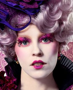 Detail of Effie Trinket in Purple with eyelashes close up. feathering on lashes