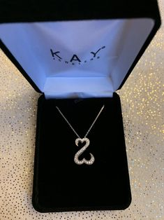 White Gold Diamond Open Heart by Kay. You can take to Kay and have warranty transferred into your name. Was worn for a couple years, but am now divorced and no longer want it. Necklace was just taken to Kay and was inspected and cleaned. Kay Jewelers, White Gold Diamonds, Body Jewelry, Silver, Necklaces, Couple, Accessories, Heart, Box