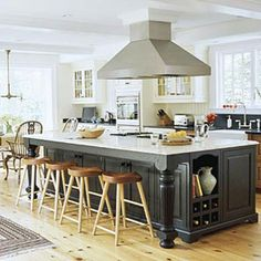 large kitchen islands - like the built-in bookcase/cubby overhang on counter for additional cabinets