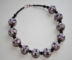 Kudin mukana: Polymeerimassa: not-so-lovely caleidoscope-millefiori made of Premo plymer clay - but the ready-made beads are nice