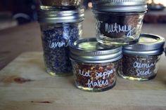 Mason jars + herbs + a white Sharpie paint pen = adorable spice storage