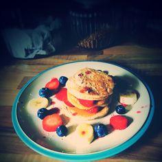 Mini Cinnamon Pancake Stacks with Fresh Fruit, Strawberry Drizzle, and Cinnamon Sugar.