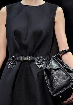 Loewe dressed up a simple black dress w/ a cool leather belt and handbag.