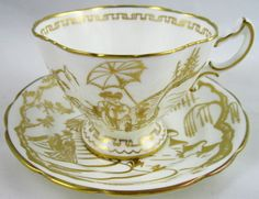 Hammersley & Co Pagoda Pattern Cup and Saucer.   Fine quality white bone china with gold Japanese pagoda pattern covering both pieces and a gold patterned inner rim to the fluted cup.