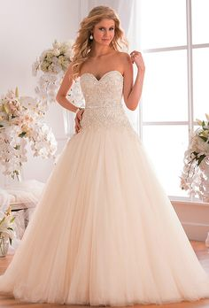 Jasmine Collection. The combination of the ball gown skirt and strapless sweetheart neckline of this gown makes it an extravagant dress for your wedding day. Elaborate embroidery beading on tulle gives the dress a flowy and glamorous feeling.