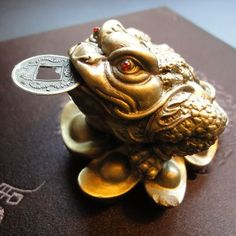 """Legend of the Money Frog """"Chan Chu"""" or the Three Legged Frog is one of the most recognized symbols for attracting wealth and abundance. In homes it is placed by the front door or on a desk.  In places of business he is often found near cash registers, reception desks, and managers offices."""