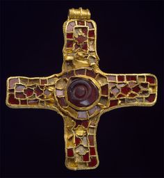 Holderness Cross  This high-status gold and garnet cross was found in Burton Pidsea on the Holderness Peninsula, East Yorkshire. It dates to the seventh century and is an early example of the Christian symbol of a cross being made in Anglo-Saxon England using a technique known from pagan jewellery of the period. The cloisonne cell work is filled with shaped garnets; only fifty-eight of the original ninety-five garnets survive.