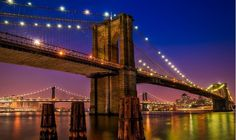 The Brooklyn Bridge is a majestic structure which crosses the East River linking Manhattan and Brooklyn. Ponte Do Brooklyn, Brooklyn Bridge New York, Manhattan Bridge, Manhattan City, Brooklyn Nyc, New York Restaurants, New York City Attractions, East River, New York Travel