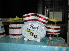 Drumset diaper cake I made based off my brother's actual drumset.  The sun, moon and star represents the celestial kingdoms.