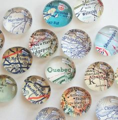 Glass. Large map/paperweights/ magnets. Could little stones and clear glue work?
