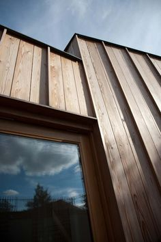 Timber Fin House in England Designed by Neil Dusheiko Architects: Wall and window detail of Timber Fin House