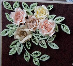 Quilled roses and leaves.  how did they make the roses?