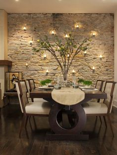 Love the stone wall and tea lights. Gives this indoor room an outdoor feel. Beautiful!