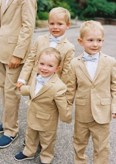 Handsome lil dudes in tan and baby blue. Floral Design by Hatch Creative Studio | hatchcreativestudio.com, Photography + Cinematography by Charlotte Jenks Lewis | charlottejenkslewis.com, Read more - http://www.stylemepretty.com/2013/06/17/bronx-wedding-from-charlotte-jenks-lewis-hatch-creative-studio/