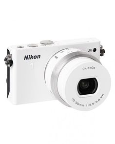 Father's Day: Our Editors Pick Great Gifts for Dad - The pocket-size Nikon 1 J4 captures fast-paced action shots; it's available with interchangeable lenses.