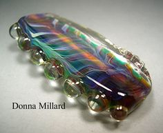 Large silver glass focal in my etsy.  Click me!