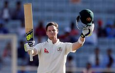 Steve Smith raises his bat to celebrate a vital century in Ranchi.