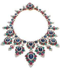 Bulgari. Statement high jewelry necklace with Sapphires, Rubies, Emeralds and Diamonds. Talk about Bling !
