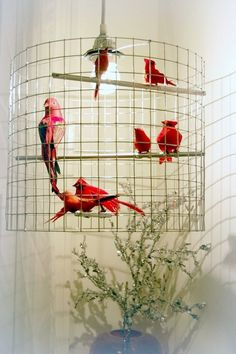 Check out the light pendants from this lovely artist...different colors, sizes & custom available!  Talk about an easy way to add character to a space!  http://www.etsy.com/listing/61348619/ruby-red-birdcage-chandelier