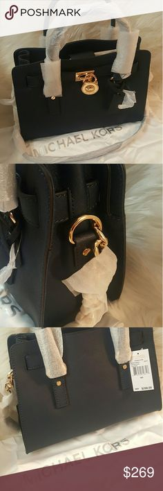 """HP🎈Best in Bags🎈* Michael Kors Hamilton Satchel* Host Pick🎊🎉🎊Best in Bags 03/18🎊🎉🎊🎉🎊🎉❤NWT* Michael Kors Hamilton Satchel * Navy* Shades of Blue add a pop of color to your wardrobe * Gorgeous Gold Toned MK Signature Hardware * Feel free to Inquire and ask Questions * Reasonable offers accepted * Bundle  & Save *Material is made of a Beautiful Navy Blue Saffiano Leathe W/ Saffiano Leather Trim and Gold Toned Chained Straps Measurements: 13""""L x 13""""H x 6""""D  Large…"""