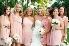 I love how the bridesmaids' dresses are the same color, but different styles. Bold move but it worked out nicely