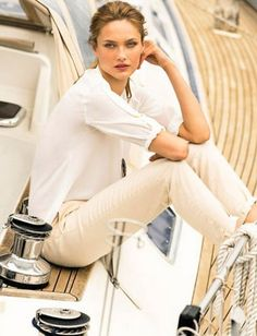 Tan pants with a white shirt. Maybe add color with jewelry.