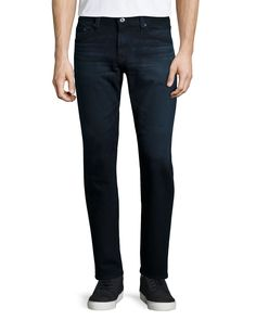 """Features AG Jeans exclusive Denim 360 fabric. Powerful all-direction stretch that delivers unrestricted movement and superior comfort.    Relaxed at the waist and tailored down the legs for a slim-straight profile, this five-pocket jean is incredibly comfortable in stretch-blend denim. Washed to an ultra- dark blue and black then finished with subtle whiskering. Zip fly, button closure. Made in the USA.      Front Rise: 9.75""""  Knee Opening: 17""""  Bottom Opening: 15.5""""  Inseam: 34""""      …"""