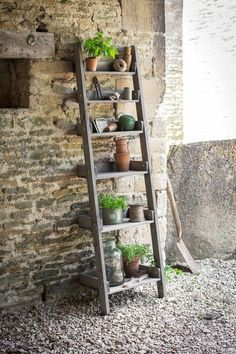 stepladder planter shelves ; Gardenista  I'm pretty sure I could grab a broken ladder or old step stool and rig it to hold plants.