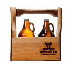 "Wooden growler tote handmade from ""beetle kill"" trees in plains #Montana. Available in our taproom and webstore: http://www.bigskybrew.com/ShopCartUser/"
