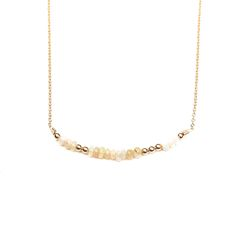 """JULIA SZENDREI OPAL MORSE CODE NECKLACE October's Birthstone. 17.5"""" set length 14K gold filled chains. Natural Ethiopian opals paired with gold bronze beads. Dits and Dashes represent the Morse Code of your choice. LOVE, JOY, BLESSED, FAMILY, XOXO, STRENGTH. Shop Now www.juliaszendrei.com"""