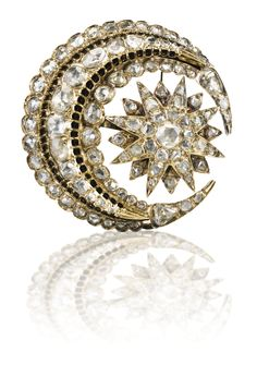 AN OTTOMAN DIAMOND BROOCH, TURKEY, EARLY 20TH CENTURY featuring a stellar form within a crescent-moon, set with diamonds, mounted with pin to reverse