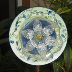 Vintage Repurpose Glass Plate Flower garden art blue green swirl egg. $35.00, via Etsy.