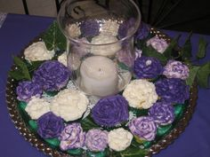 Cupcakes and candles for centerpieces - Ryan wants cupcakes at the tables :)
