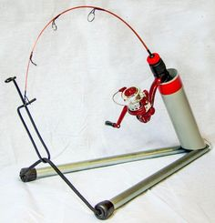 THE TRIGGER Compact, foldable and lightweight, this Canadian-made ice rod holder uses the rod's own tension and a crafty trigger system Fox Fishing, Ice Fishing Gear, Saltwater Fishing Gear, Walleye Fishing, Fishing Knots, Fishing Bait, Women Fishing, Carp Fishing, Fishing Tackle