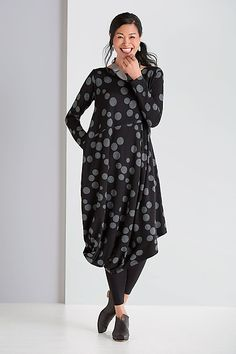 Fun and cozy, this perfect fall dress is enlivened by playful polka dots…