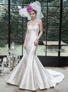 Rich and luxurious Elodie Mikado creates this dramatic mermaid wedding dress, complete with voluminous skirt, and lace adorned bodice, sparkling with Swarovski crystals. Finished with sweetheart neckline and corset closure.  Maggie Sottero Bridal - 5MS619-Betty
