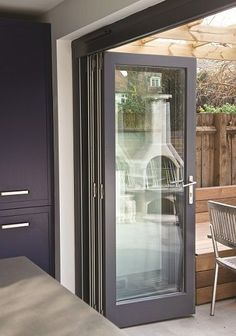 timber bifold door and installed by the sash window workshop