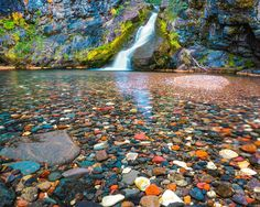 """""""Polychrome Pool"""", Three Sisters Wilderness, Central Oregon. This enchanted little pool, located high in the Three Sisters Wilderness Area of Central Oregon, has the most colorful collection of rock of any I've seen in the state of Oregon! Photogenic waterfalls, transparent, blue tinted pools, and the aforementioned stream rocks make for a stunning art photograph … for more information about this beautiful photograph, please visit,http://mikeputnamphoto.com"""