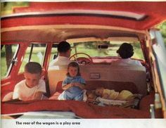 Rear of the station wagon as a play area while driving . . . in the day